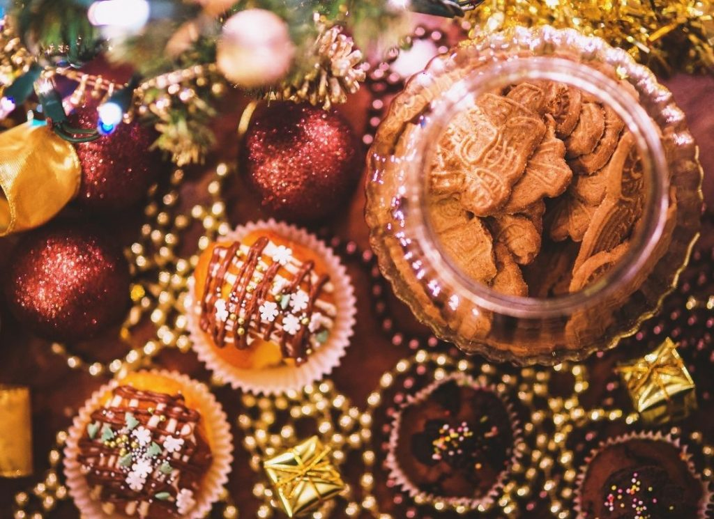 Traditional holiday planner spread on Christmas with ornaments, cookies and cupcakes
