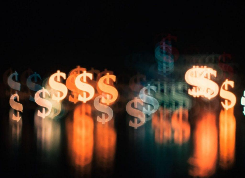 money sign lights on dark background