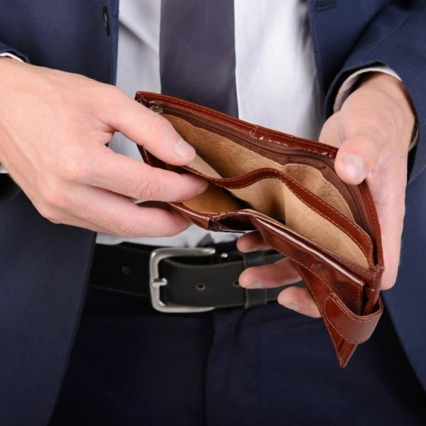 Man holding an empty brown wallet
